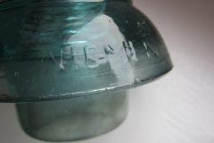 UFO style vintage glass insulator with embossings