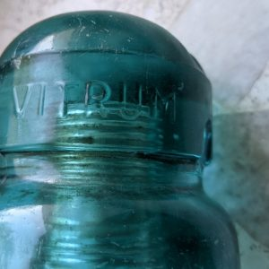 old glass insulator with rare embossing - Vitrum